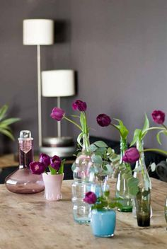 Love purple tulips and this arrangement of vases.