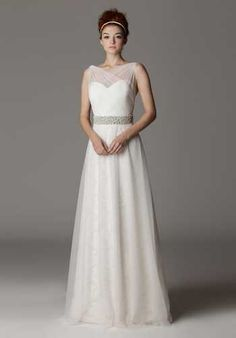 Sweetheart neckline wedding dress with crossover illusion neckline. Constructed with garment boning in front for a more secure fit. Entire dress is made with our ivory lace and spring tulle overlay.