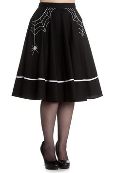 Little Miss Muffet sat on a tuffet... wearing this fabulous 50's style, circle skirt! Black with white embroidery of spider webs coming from the pockets with a spider on the right hand side. Featuring a white cotton stripe around the hem and white piping along the opening edge of pockets. Zip at the center back to fasten with a button covered in white fabric at the back on the waistband to fasten.   Miss Muffet Skirt by Hell Bunny. Clothing - Skirts Omaha, Nebraska