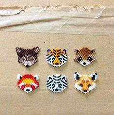 Charlotte SouchetさんはInstagramを利用しています:「✨🐯La collection Wild 🦊✨ #miyuki #perlesmiyuki #miyukidelica #miyukibeads #diy #handmade #brickstitch #love #wild #fox #bear #tiger #raccoon…」 Hama Beads Patterns, Seed Bead Patterns, Peyote Patterns, Beading Patterns, Bracelet Patterns, Perler Bead Art, Perler Beads, Bead Jewellery, Seed Bead Jewelry