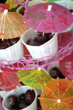 cups of grapes with parasol for Luau/Pool Party.....via And Everything Sweet: Bailey's Pool Party
