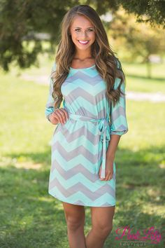 Our favorite Mint and Grey Chevron pattern now comes in this adorable new 3/4 sleeve version! This lightweight dress is perfect to wear anytime of the year and for multiple occasions.