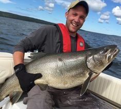 Nik Biebighauser of Minneapolis held the monster 45-pound lake trout he and his dad, Dave, caught in Lake Superior near Isle Royale National Park. They released the 47-inch fish,which would have been a state record had it been caught