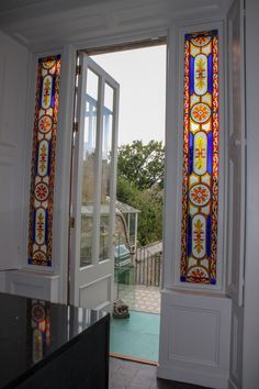 This was a sash window originally. We extended it down to make a huge tall door with large glazed sections and panelling to match the door frame. The wonderful stained glass is original. We installed secondary glazing to maintain thermal efficiency around them. Sash Windows, Casement Windows, Windows And Doors, Garden Doors, Patio Doors, Window Replacement, Panelling, Stained Glass