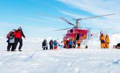 """""""Global warming"""" scientists stuck in ice rescued by helicopter."""