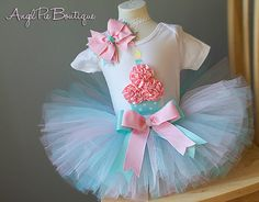 Baby Girl's First Birthday Outfit - Onesie, Pastel Tutu and Matching Headband - Tiffany Blue and Baby Pink. $39.99, via Etsy.