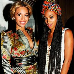Beyoncé Knowles in a printed dress with a black belt // Solange Knowles in a white top and printed head scarf