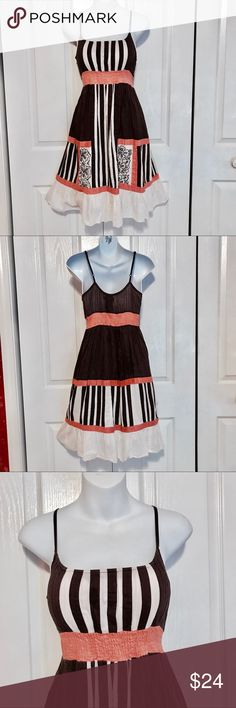 Free people dress Pretty free people dress. 100% cotton. Chocolate brown and light coral. Adjustable straps. Soft , lightweight and pretty. Free People Dresses
