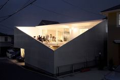 House kn by Kochi Architect's Studio, Miura City, Kanagawa, Japan. Cut from a box enclosing the whole plot this residential property divides up and efficiently uses the entire site. As Kazuyasu Kochi describes it: 'First, I put a big box on the whole of the site, and then made a big void as a type of window.'