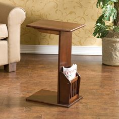 Reduce the clutter in your living room with this convenient espresso-colored magazine snack table. The small table has a narrow design that slides easily into small spaces or over your lap and features a convenient side basket for magazines and books.