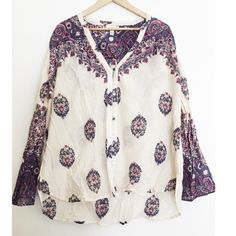 """Billabong Boho Bell Sleeve Blouse A beautiful lightweight semi sheer top by Billabong Designer's Closet-- this top has a pretty color scheme of purple, real and tan on a cream background. Bell sleeves and a mismatch of buttons add a unique touch to this boho babe top. 100% cotton. Approx measurements: length 28"""" 