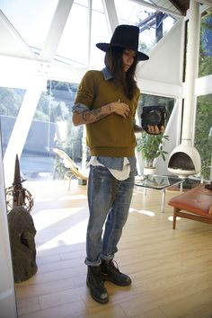 Tasya van Ree in a vintage Stetson hat, J Crew sweater, Vintage Levis denim shirt, Rick Owens tank and Prps Heirloom pants.