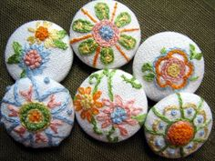 https://flic.kr/p/7ShtCJ | Untitled | for the embroidered button swap...these went to Bekah of Beetastic  i was going for a vintage feel...i chose spring-ish floss colors and made sure to include each color at least once.  all the stitching is free form and random...