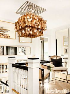 The upstairs landing's showstopping capiz-shell chandelier from Z Gallerie provides a dose of glamour amid more simple touches.