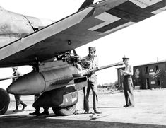 """A Junkers Ju 87 Stuka """"Kanonenvogel"""" (Cannon-Bird) is having her Bordkanone BK cannons inspected by British soldiers. The two underwing cannons were loaded with two six-round magazines of armor-piercing tungsten carbide-cored ammunition. Fighter Aircraft, Fighter Jets, Navy Carriers, Ah 64 Apache, British Soldier, Fun Shots, United States Navy, Luftwaffe, Cannon"""