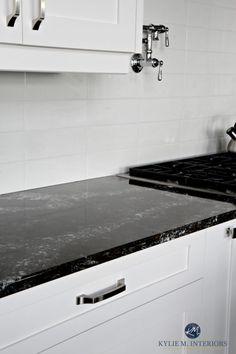 Cambria Ellesmere black quartz countertop, white kitchen cabinets and off-white light gray subway tile backsplash. Kylie M Interiors Decorating and Design