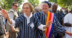 Former President Jimmy Carter, (shown here on a trip to Ghana with his wife, Rosalynn) has melanoma in his brain, but new treatments may help him beat the disease. ~~ Louise Gubb/The Carter Center