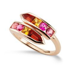 JANE TAYLOR ~ A delicate yet vibrant arrow bypass ring, filled with garnet and tourmaline.