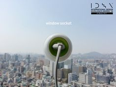 """""""Plug It On The Window      The Window Socket offers a neat way to harness solar energy and use it as a plug socket. So far we have seen solutions that act as a solar battery backup, but none as a direct plug-in. Simple in design, the plug just attaches to any window and does its job intuitively.      Designers: Kyuho Song & Boa Oh""""."""
