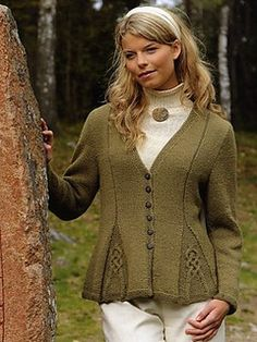 Long-sleeved, V-neck cardigan with a very feminine and flattering shape, created by gussets and the purl lines emanating from them.