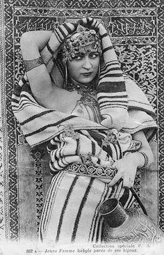 Africa | Kabylia girl in festive dress.  Algeria || Scanned vintage postcard;  publisher Neurdein