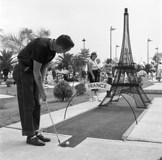 Pontchartrain Beach-Caption:circa Aiming the ball under a model of the Eiffel Tower on the miniature golf course at Pontchartrain beach, Louisiana. (Photo by Three Lions/Getty Images) Tour Eiffel, Indoor Miniature Golf, Golf With Friends, Beach Captions, Cheap Golf Clubs, Golf Card Game, Golf Cart Parts, Dubai Golf, Golf Apps