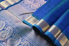 """A unique MS #Blue with a rich """"arai madam"""" border in the border. The pallu is grand and lustrous with pure zari - a combination of the #traditional #mango and half #diamond design! Stunning!"""