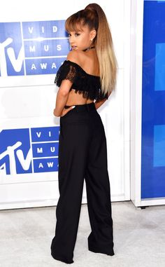 The nominee shows some skin in an off-the-shoulder lace crop top and coordinating black pants.