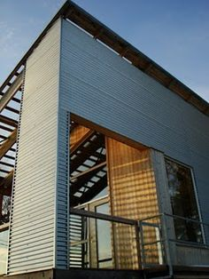 Corrugated Metal Siding mixed with a little Austin stone and cedar.  Yes!