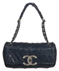 Chanel Navy Lambskin Stitch Handbag Shoulder Bag. Get one of the hottest styles of the season! The Chanel Navy Lambskin Stitch Handbag Shoulder Bag is a top 10 member favorite on Tradesy. Save on yours before they're sold out!