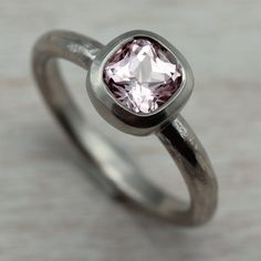 Our 5mm Rustic Cushion Cut Engagement Ring, with a light pink Chatham-made Padparadscha Sapphire set in 14k White Gold.
