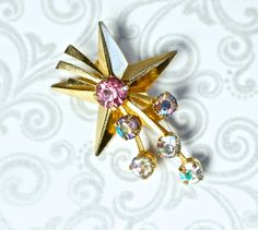 "Vintage Rhinestone Star Brooch Coro Petite Gold Plate Petitie & lovely.    Size: 1.27"" x .92""       $11.00 SOLD"