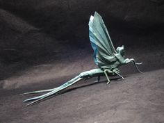 """Mayfly V.2      """"Best Insect"""", 2006-7 MIT Origami Contest.    folded from an uncut square   designed by Brian Chan   September 2006"""
