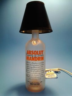 Absolut® Mandrin Liquor Bottle Table Lamp W/ Black Shade  This is a Quality Handmade Liquor Bottle Table Lamp  This liquor bottle lamp is a unique way to light your home, whether on a table, bar or buffet, it's sure to make an impression! Contains: * 5″ Fabric Shade * Push Through On and Off Switch w/ 36″ 110v Cord * 30W-40w Bulb * Approx. 16″ Overall Height  - See more at…