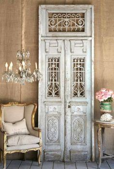 .ornate vintage door used as decor with formal wingback chair