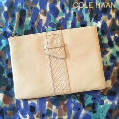 COLE HAAN Leather Cream Pouch Style Clutch Luxurious pebbled leather with zippered top gold tone hardware with gold imprinted Cole Haan logo on front. Woven leather strips decorate front. Cole Haan Bags Clutches & Wristlets