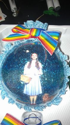 Dorothy - wizard of oz  Homemade with glitter inside ball using mop and glow.  outside scrapbook stickers sealed with mod podge and ribbon found in fabric section.  So easy!