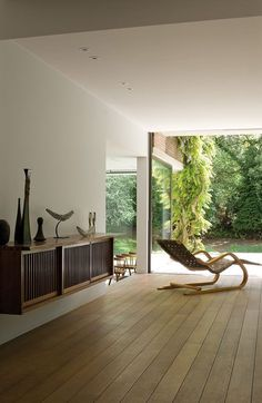 Kelly Martin Interiors - Blog - Bringing the Outside In ***** interior design, home, decor, decorating, plant life, naturalistic, nature, trees, outdoor, green, white, black, bohemian, mid century modern, eclectic, transitional, contemporary, dining, living room
