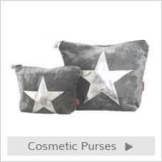 Velvet star makeup and cosmetic bags with handsitched silver star. Each bag is satin lined with a zip top finished with a beaded ball.