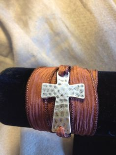 Hammered Cross and Silk Wrap Bracelet by AdornmentsbyGwen on Etsy, $25.00