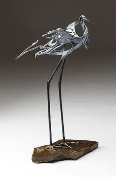 Light and airy, yet sizable and with a powerful presence, a majestic, cast bronze egret raises its wings as if to take flight. Dance by Sandy Graves