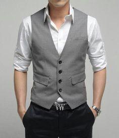 Black pants, grey vest and white shirt