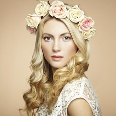 Portrait of a beautiful blonde woman with flowers in her hair - Portrait of a beautiful blonde woman with flowers in her hair. Fashion photo