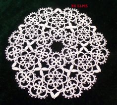Triangle Doily designed by Nadia Kukochkina ... with tatting pattern diagram for the triangle motifs.
