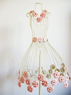 flower on wire dress form. I want one of these for my sewing room  i need one for every room