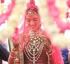 In the typical olden days, brides covered their faces with heavy veils to show purity and coyness. The traditional wedding gown was that of red hues and white with heavy embroidery and a large chun…