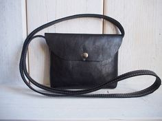 Leather crossbody bag with flap and snap button closure. #Crossbodybag #leatherbag #blackleatherbag #Yicke