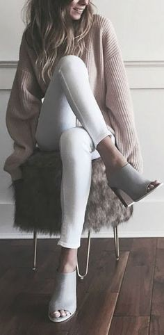 A chunky sweater with white jeans and open toe mules