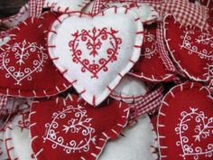 Scandinavian embroidery design looking gorgeous on felt hearts