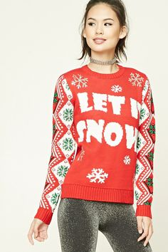 """A midweight knit sweater featuring a """"Let It Snow"""" graphic on the chest, a mixed snowflake print along the front and sleeves, sequined snowflake appliques, a crew neckline, long sleeves, and ribbed trim."""